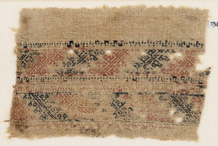 Textile fragment with bands of S-shapes and stylized shapes, possibly flowers