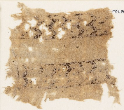 Textile fragment with bands of double chevrons and flowers