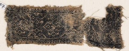 Textile fragment with bands of ornate diamond-shapes and hooks