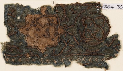 Textile fragment with star and interlocking circles