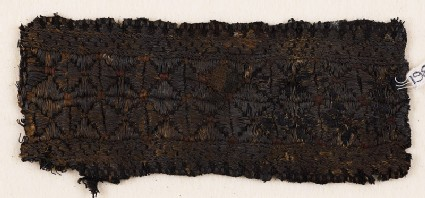 Textile fragment with band of stars or flowers