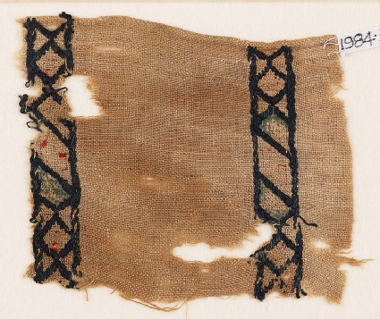 Textile fragment with rhombuses and diamond-shapes