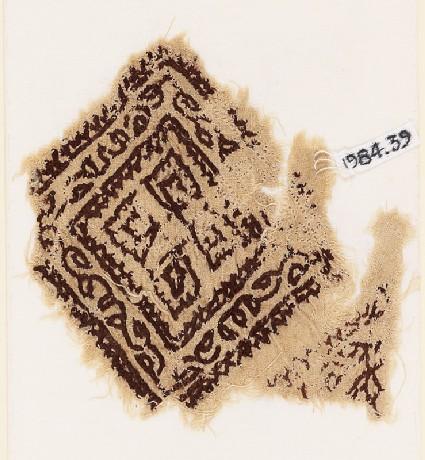 Textile fragment with square, vine, and quatrefoil