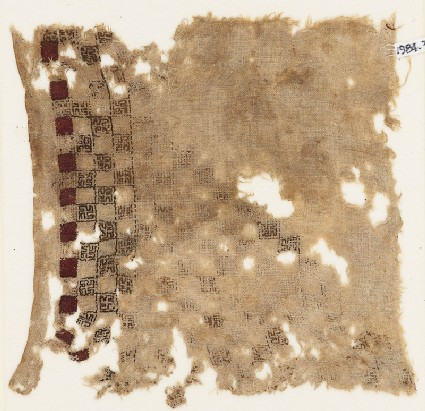 Textile fragment with swastika-filled squares