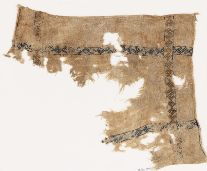 Textile fragment with S-shapes and diamond-shape borders