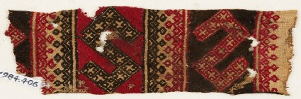 Textile fragment with two large S-shapes