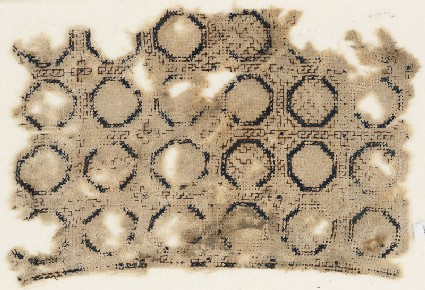 Textile fragment with circles set into a grid