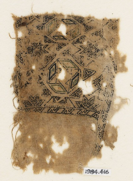 Textile fragment with eight-pointed stars and lozenges