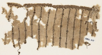Textile fragment with reversed S-shapes, possibly from a tunic
