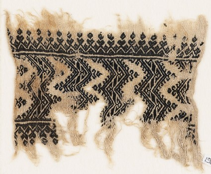 Textile fragment with chevrons with hook borders