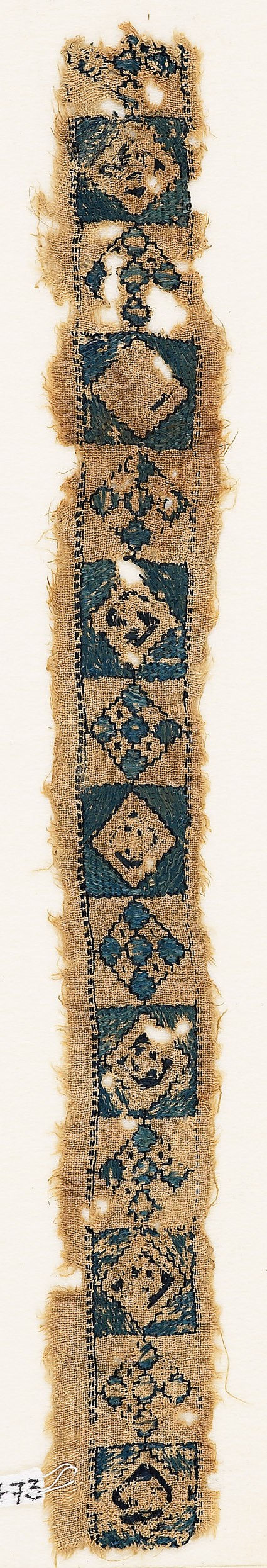 Textile fragment with alternating diamond-shapes and quatrefoils