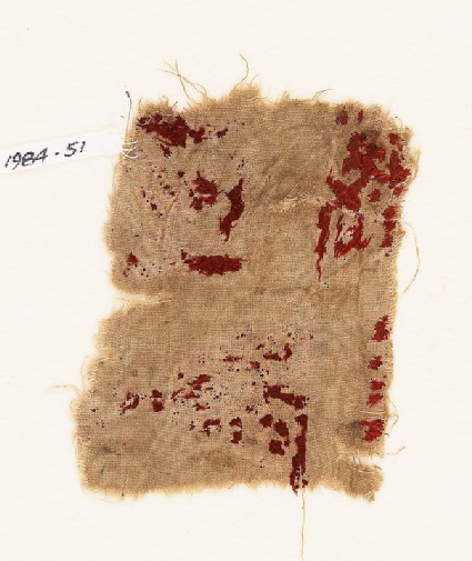Textile fragment, possibly with remains of kufic interlace