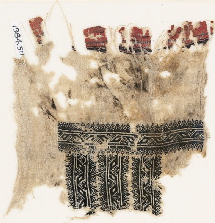 Textile fragment with three parallel bands with lozenges