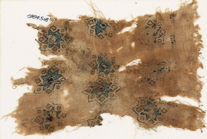 Textile fragment with stars and diamond-shapes