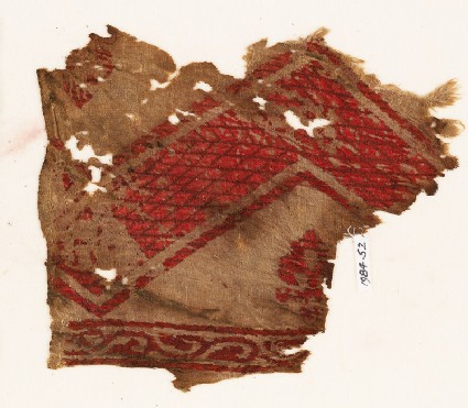Textile fragment with chevron, fleur-de-lys, and vine