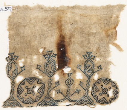 Textile fragment with three stylized trees