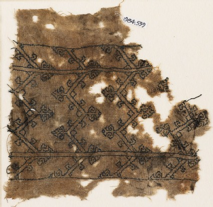 Textile fragment with chevrons and tendrils