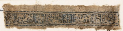 Textile fragment with eight-pointed stars and inscription