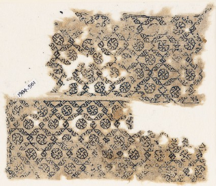 Textile fragment with diagonal grid containing rosettes