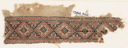 Textile fragment with linked diamond-shapes containing eight-pointed stars