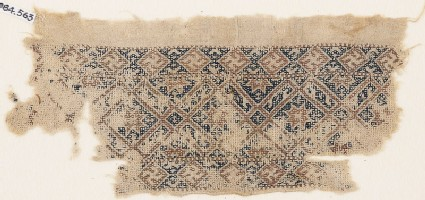 Textile fragment with diamond-shapes containing stars
