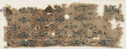 Textile fragment with diamond-shapes set into a diagonal grid