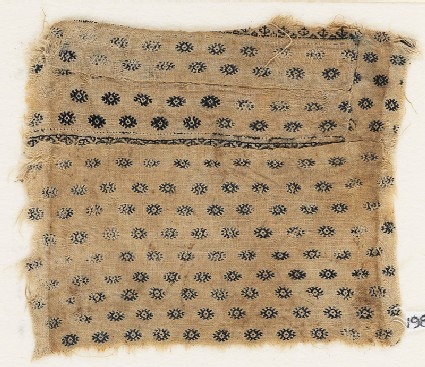 Textile fragment with flowers or diamond-shapes, possibly from a garment