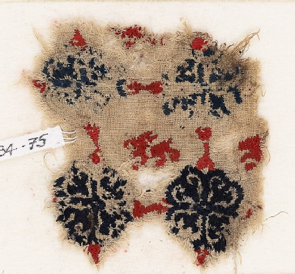 Textile fragment with lion and grid of quatrefoil flowers