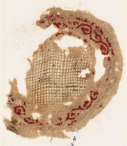 Roundel textile fragment with vine border