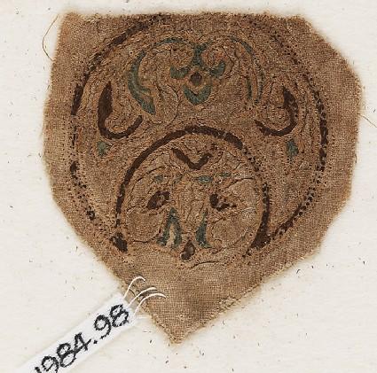 Roundel textile fragment with blazon