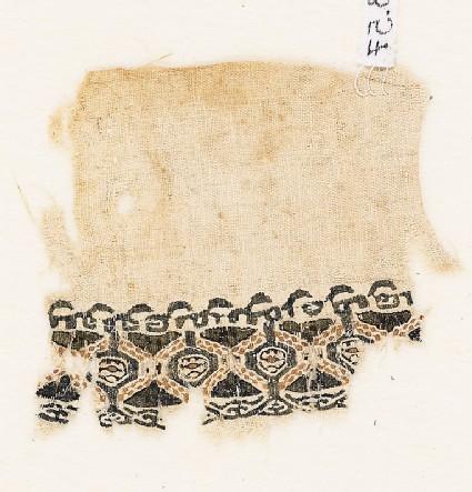 Textile fragment with pseudo-inscription border