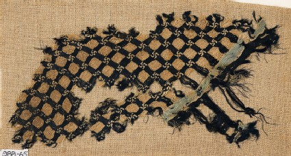 Textile fragment with grid and swastikas