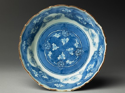 Bowl with foliated rim and floral scrolls