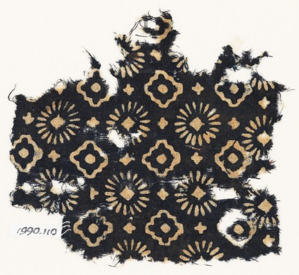 Textile fragment with rosettes, stepped squares, and crosses