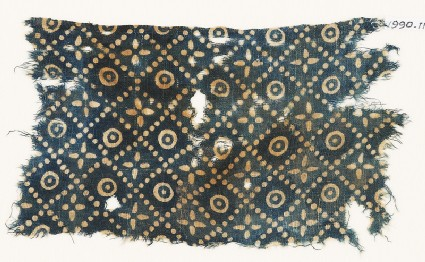 Textile fragment with dots, quatrefoils, and circles