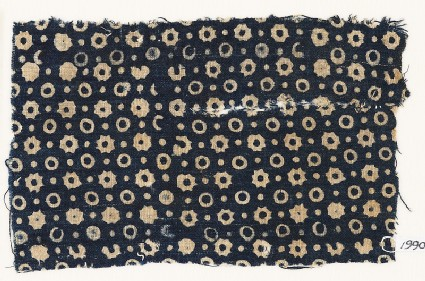 Textile fragment with rings, stars, and dots