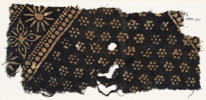Textile fragment with rosettes and band with floral shapes