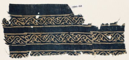 Textile fragment with bands of vines and leaves