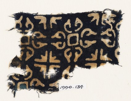 Textile fragment with quatrefoils and groups of four arrows
