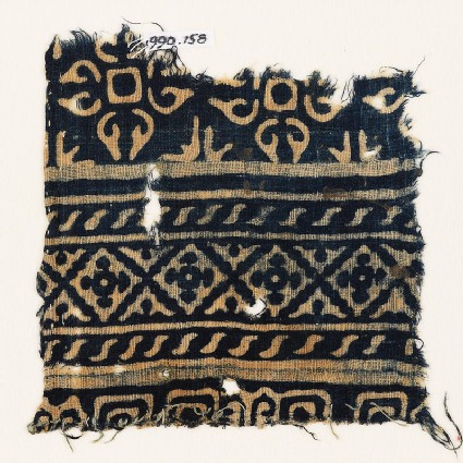 Textile fragment with diamond-shapes, S-shapes, and quatrefoils