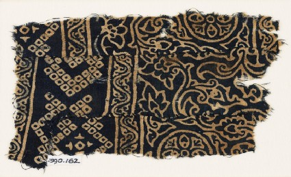 Textile fragment with rosettes, leaves, flowers, and bandhani, or tie-dye, imitation