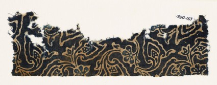 Textile fragment with swirling flower-heads and leaves