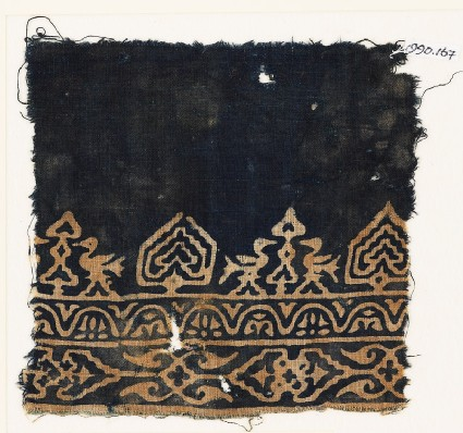 Textile fragment with birds, possibly tree-shapes, and stylized plants