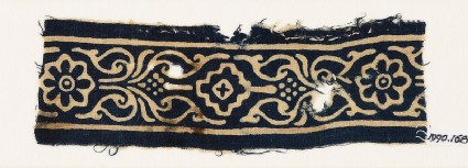 Textile fragment with rosettes, stylized leaves, and a diamond-shape