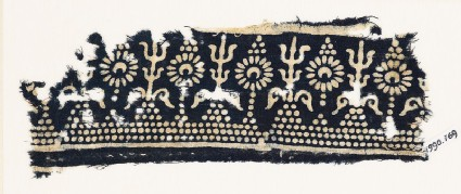 Textile fragment with stylized trees and flowers
