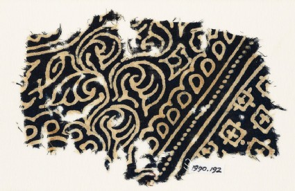 Textile fragment with swirling tendrils, tear-drops, and squares