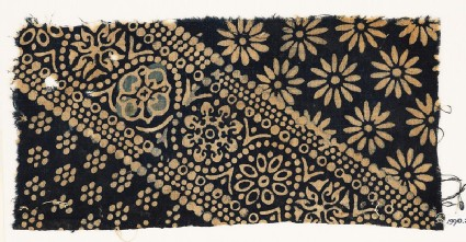 Textile fragment with ornate, dotted, and large rosettes