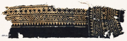 Textile fragment with sawtooth edge, vine, and crosses