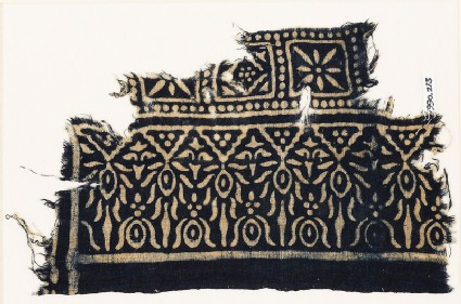 Textile fragment with squares and stylized trees