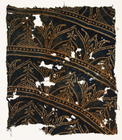 Textile fragment with arches and plants
